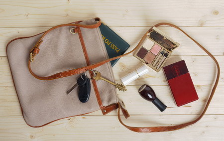 female bag with a variety of personal belongings