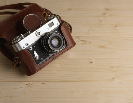 Old retro camera on background of wooden boards Stock Photo