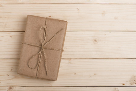 brown paper: Vintage gift box on wooden background