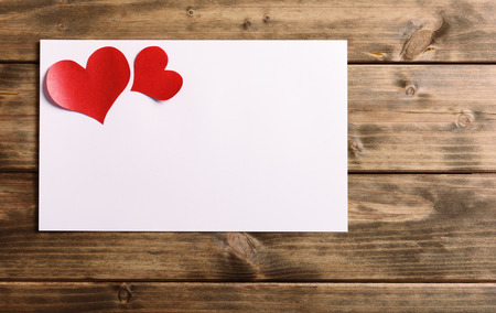 greeting card with a red heart and space for text on a wooden background photo
