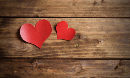 two red hearts on a wooden background. valentines day photo