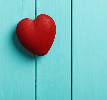 red heart on a blue wooden background Stock Photo