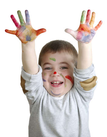 smeared hand: happy little boy with paints on palms isolated on white background Stock Photo