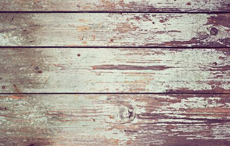Old wooden background with light cracked paint