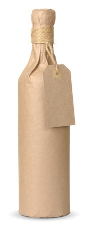 markdown: bottle of wine wrapped in kraft paper with a price tag isolated with clipping paths Stock Photo