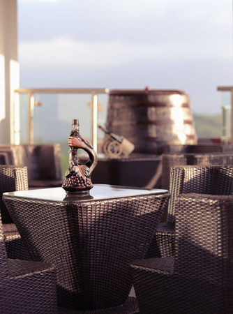 a table with a bottle of wine in the summer restaurant Stock Photo