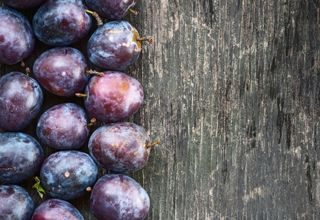 Fresh ripe plum on a wooden background Stock Photo
