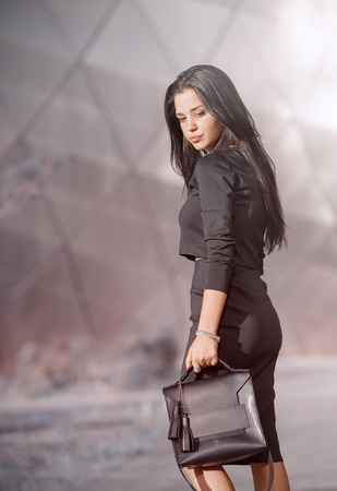 beautiful young woman with a handbag Stock Photo