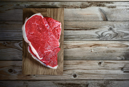 fresh meat fillet on wooden background