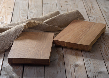 Two empty  chopping boards for dishes on wooden background