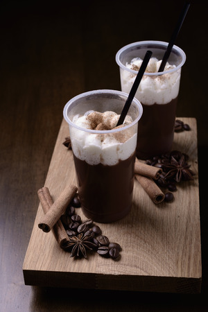 Iced coffee with straw on a wooden table Stock Photo