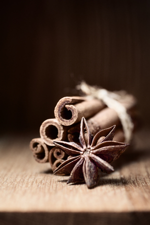 cinnamon and anise on wooden table with blurred background Stock Photo