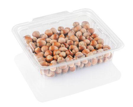 hazelnut on a white background in a transparent container isolated on a white background