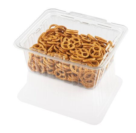 crackers in a transparent plastic container on a white background isolated Stok Fotoğraf