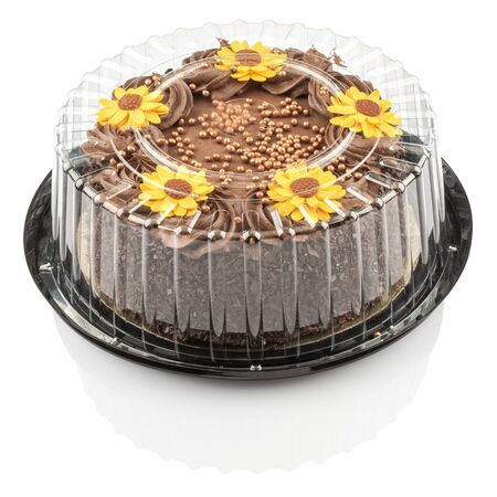 cake with chocolate cream and decorated with yellow flowers isolated on a white background
