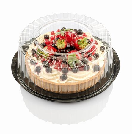 tartlet with cream and fruit isolated on a white background