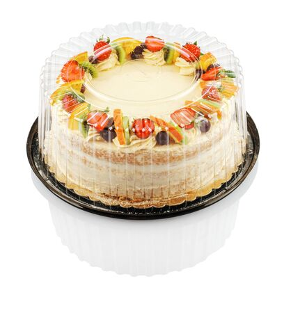round cake with fruit and berries in a plastic container isolated on a white background