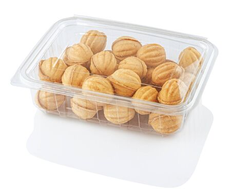 round cookie nuts in a transparent food container, isolated on a white background