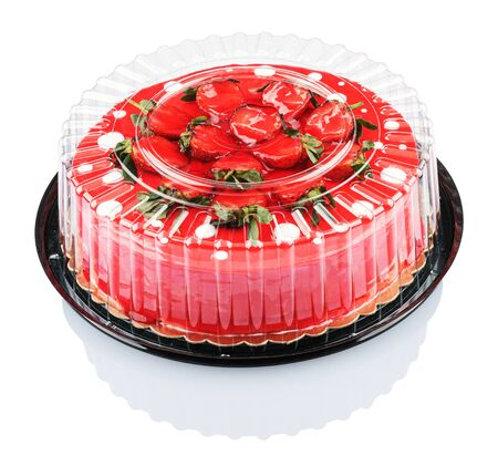 red cake with strawberries isolated on white background