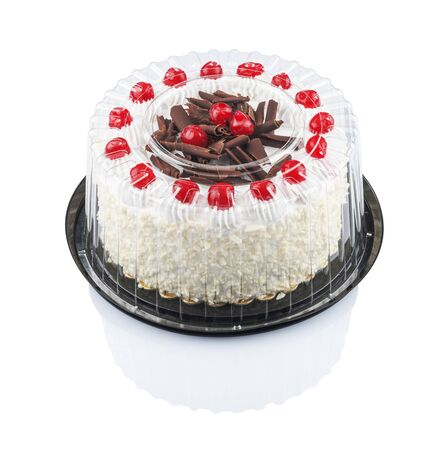 cake with cherries and chocolate in a plastic disposable container, isolated on a white background