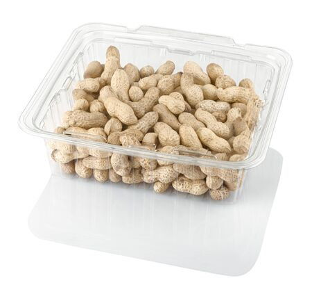 peanuts groundnuts in a transparent plastic box isolated on a white background with clipping path