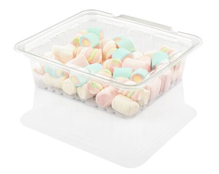 marshmallow candy in a plastic container isolated on a white background with clipping path