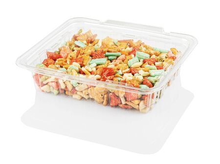 multicolored candy in a disposable plastic container isolated on a white background with clipping path