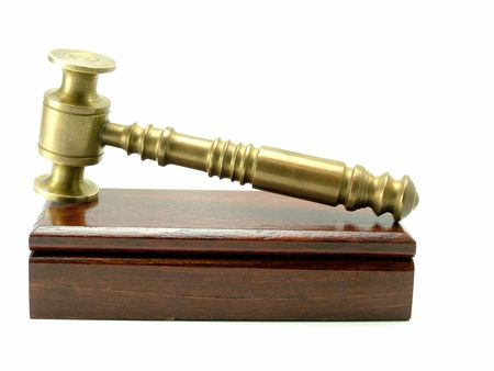 A brass judges gavel on a varnished wooden box. Original image has been photographed at very high resolution. Stock Photo