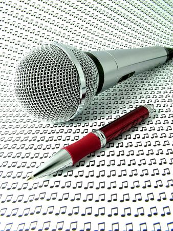 A professional sound microphone with red pen - surrounded by musical notes. Stock Photo