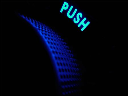 Neon word push glows in a dark blue haze above a power and volume handle.