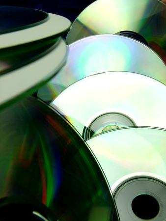 dvdr: Dozens of CD and DVD ROM discs arranged at differing distances. Stock Photo