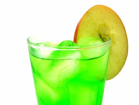 A cool green drink with ice and a slice of apple