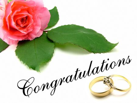 Pink rose with green rose leaves, congratulations wording and wedding and engagement rings over white background. Stock Photo