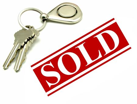 sold: Sold sign and two keys on a key ring. Real estate sale and purchase concept. Stock Photo