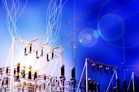Lightning and electricity streaks from live power lines and wires at an electrical substation