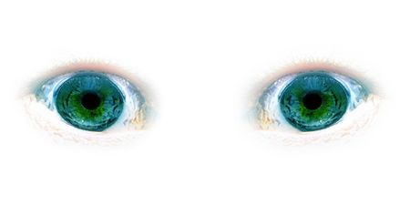 Green eyes looking forward with faded white background Stock Photo