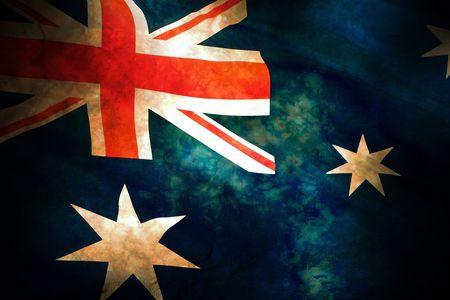 Old battle damaged weathered Australian flag hand painted on stone Stock Photo
