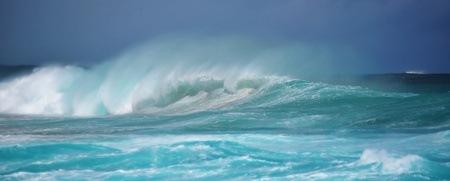 Wild surfing scene with wind-driven sea spray
