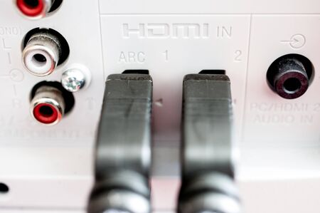 hdmi: Two HDMI cables connected to the TV