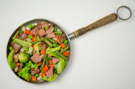 Beef fried with vegetables in a pan. photo