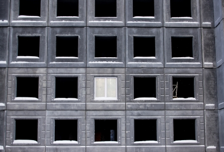 Unfinished building of reinforced concrete panels without windows photo