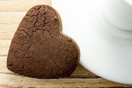 Chocolate heart cookies on the coffee saucer. photo