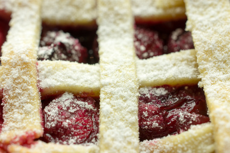 Cherry pie with lattice top close-up. photo