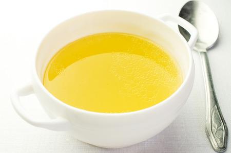Broth, bouillon in a ceramic bowl. Next vintage spoon