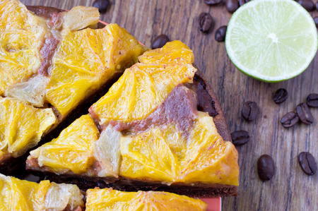 orange tart: Orange tart cake dessert with Coffee beans, lime and lemon