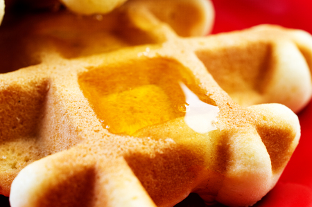 Waffles homemade with honey on a plate photo