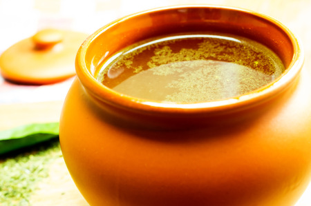 bouillon: Broth, bouillon, clear soup in a clay pot, close-up Stock Photo