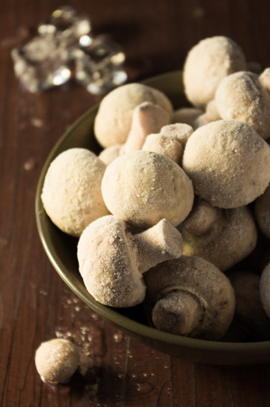 prepack: Frozen mushrooms in a bowl close up