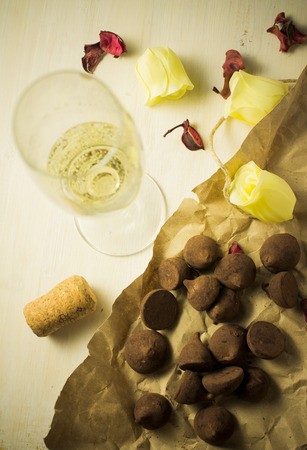 champagne truffles chocolate: Champagne white sparkling wine and chocolates truffles Stock Photo