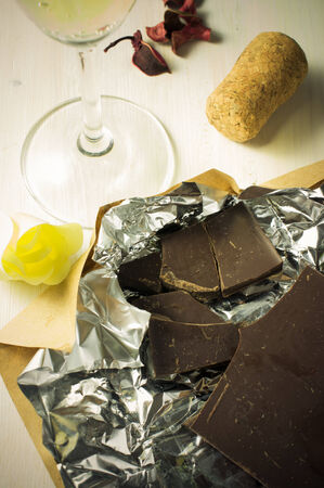 champagne truffles chocolate: Bar of chocolate on a table near the goblet of wine Stock Photo